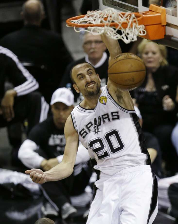 Manu Ginobili dunks during the second half. Photo: David J. Phillip, Associated Press