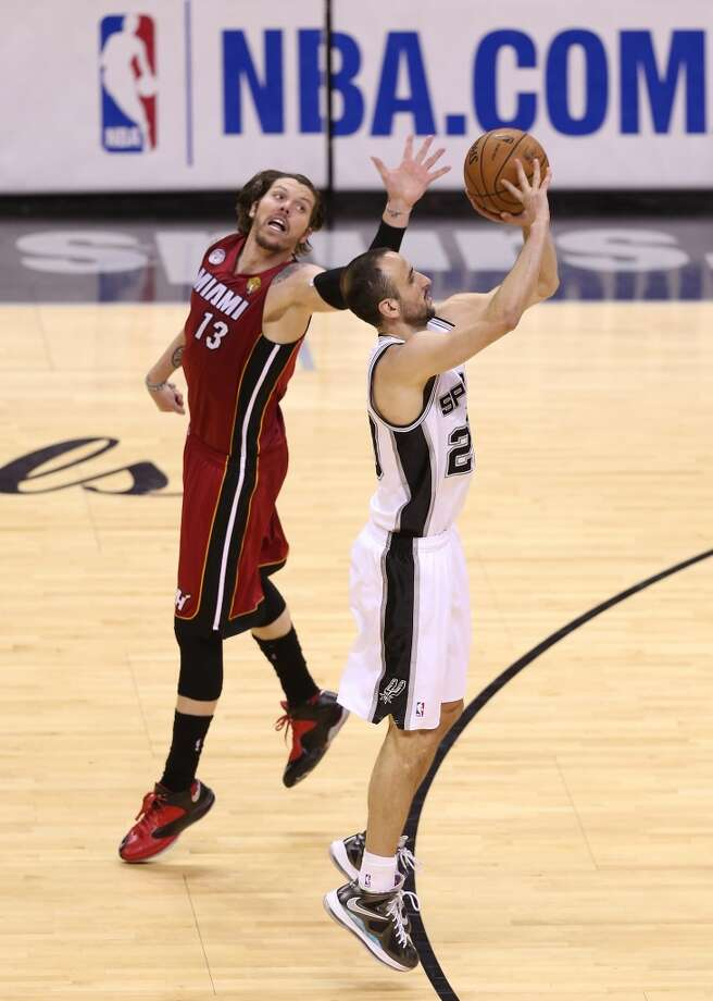 Manu Ginobili #20 of the Spurs makes a three-pointer against the Heat in the second half. Photo: Christian Petersen, Getty Images