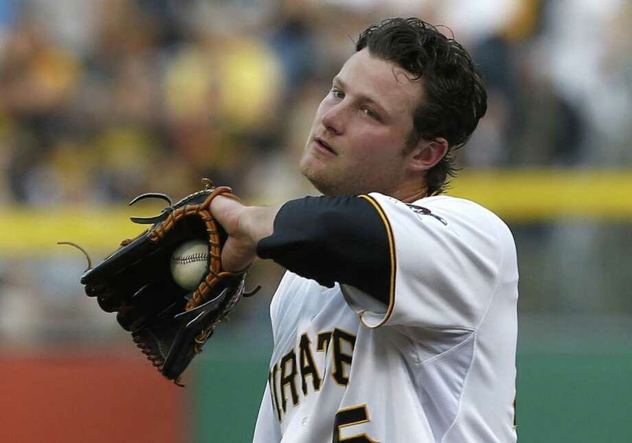 Pirates rookie pitcher Gerrit Cole, wiping his face in the fifth, didn't walk a batter in 61/3 innings. Photo: Keith Srakocic / Associated Press