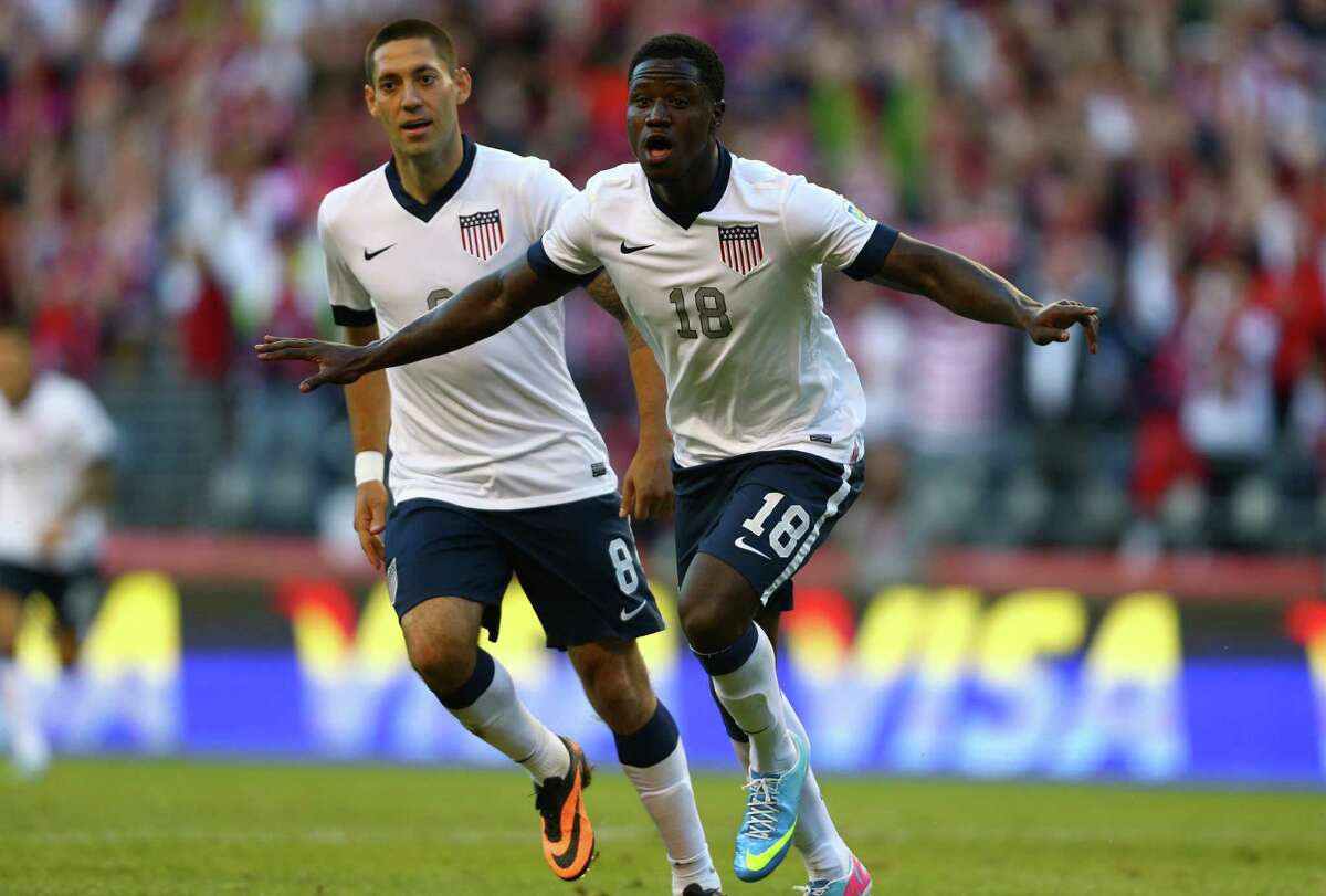 U.S. player Eddie Johnson (18) reacts alonside teammate Clint Dempsey after Johnson scored a goal against Panama in the second half on Tuesday, June 11, 2013 at CenturyLink Field in Seattle. The game was a qualifier for the World Cup to be held in 2014. The U.S. defeated Panama 2-0.