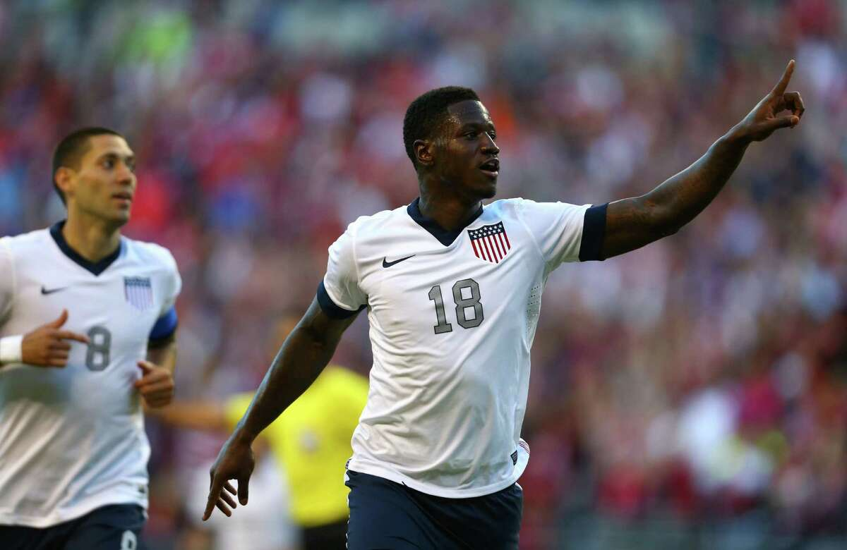 U.S. player Eddie Johnson (18) reacts along side teammate Clint Dempsey after Johnson scored a goal against Panama in the second half on Tuesday, June 11, 2013 at CenturyLink Field in Seattle. The game was a qualifier for the World Cup to be held in 2014.