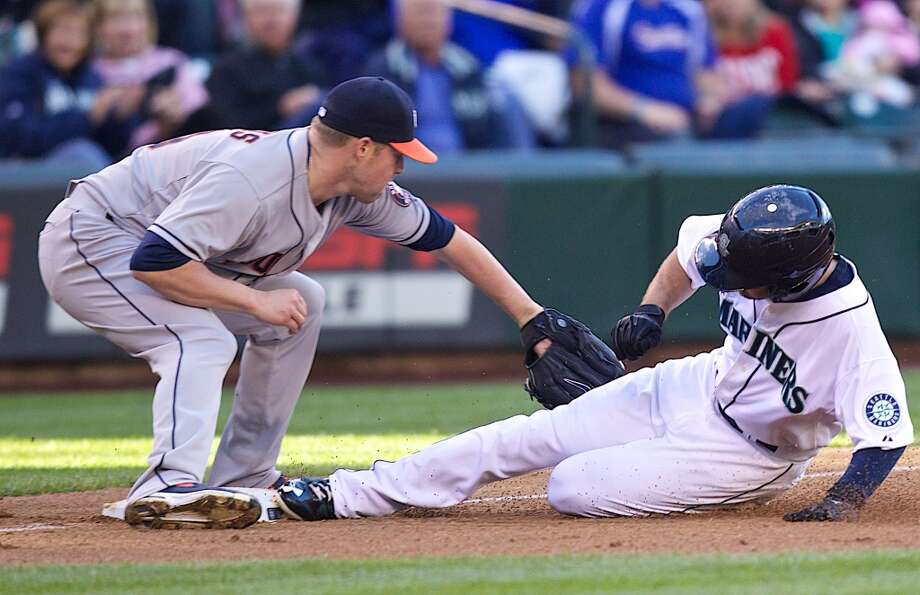 June 11: Mariners 4, Astros 0  Nick Franklin #20 of the Mariners slides safely into third base as Matt Dominguez #30 attempts a tag. Photo: Stephen Brashear, Getty Images