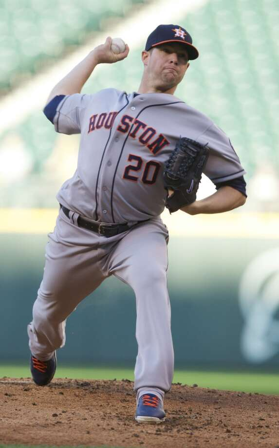 Bud Norris #20 delivers a pitch. Photo: Stephen Brashear, Getty Images