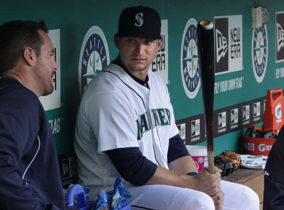 Mike Zunino, called up to the majors from AAA Tacoma Rainiers, sits in the dugout.
