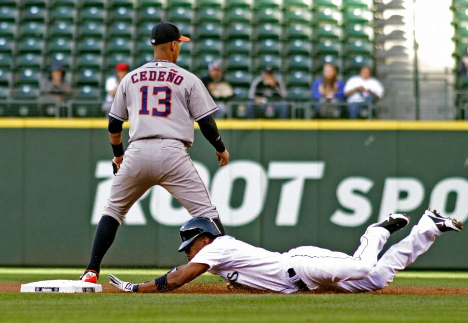 Endy Chavez makes it safely to second on a double in front of Ronny Cedeño. Photo: Marcus R. Donner, Associated Press