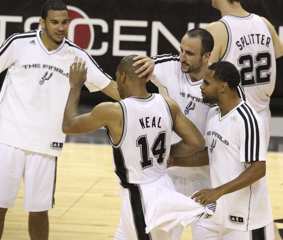 Gary Neal (14) is congratulated during the second half of Game 3 of the NBA Finals at the AT&T Center on Tuesday, June 11, 2013.