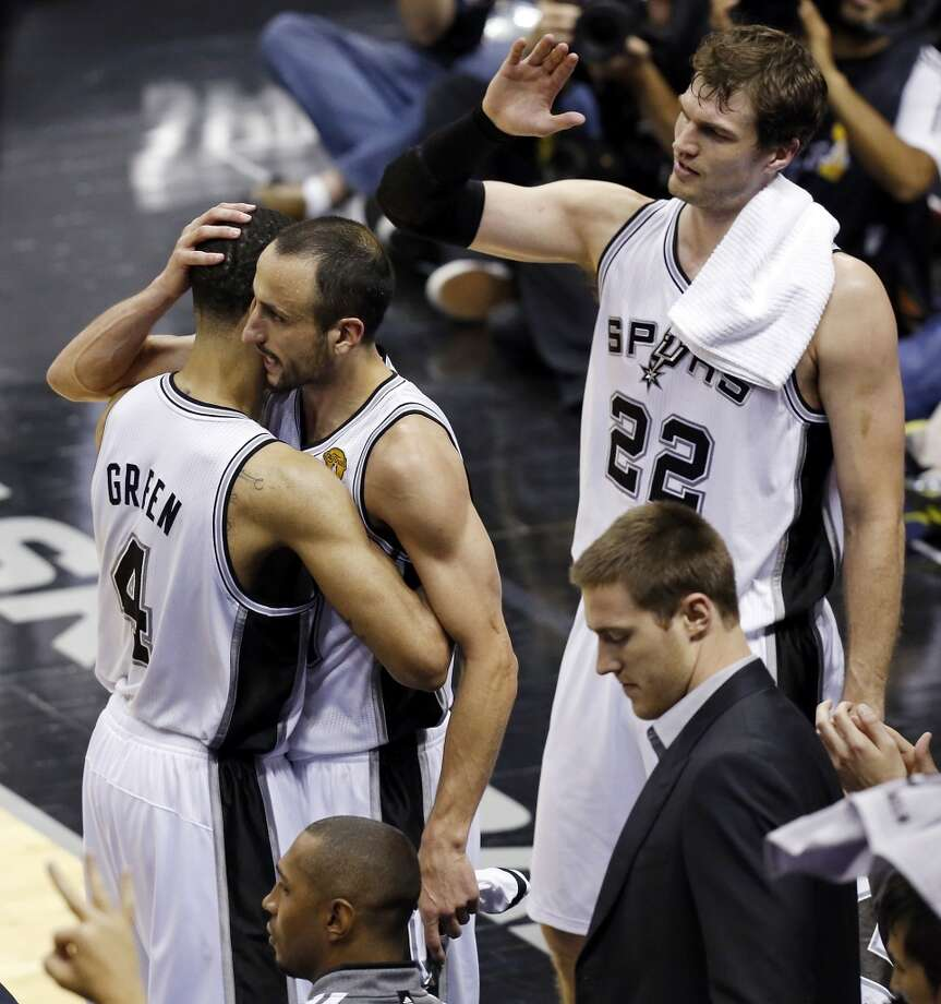 San Antonio Spurs' Danny Green celebrates with San Antonio Spurs' Manu Ginobili and San Antonio Spurs' Tiago Splitter on the bench during the second half of Game 3 of the 2013 NBA Finals against the Miami Heat Tuesday June 11, 2013 at the AT&T Center. The Spurs won 113-77.