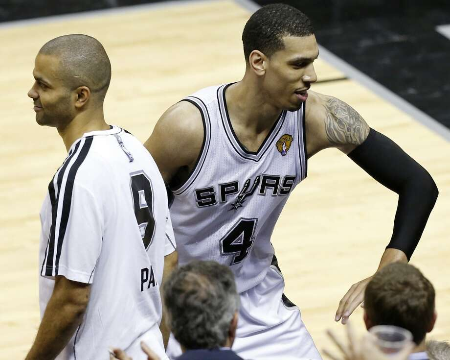 San Antonio Spurs' Tony Parker celebrates with teammate San Antonio Spurs' Danny Green on the bench during the second half of Game 3 of the 2013 NBA Finals against the Miami Heat Tuesday June 11, 2013 at the AT&T Center. The Spurs won 113-77.