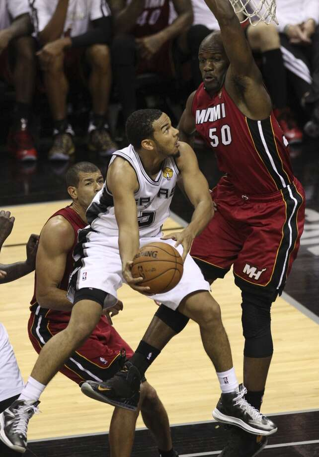 Cory Joseph (05 drives past Joel Anthony (50) during the second half of Game 3 of the NBA Finals at the AT&T Center on Tuesday, June 11, 2013.