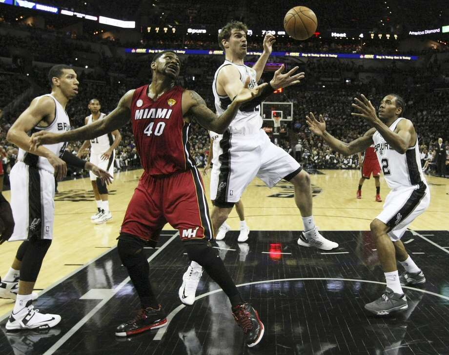 Heat's Udonis Haslem grabs for a rebound between Spurs' Danny Green (04), Spurs' Tiago Splitter (22), and Spurs' Kawhi Leonard during the first half of Game 3 of the NBA Finals at the AT&T Center on Tuesday, June 11, 2013.