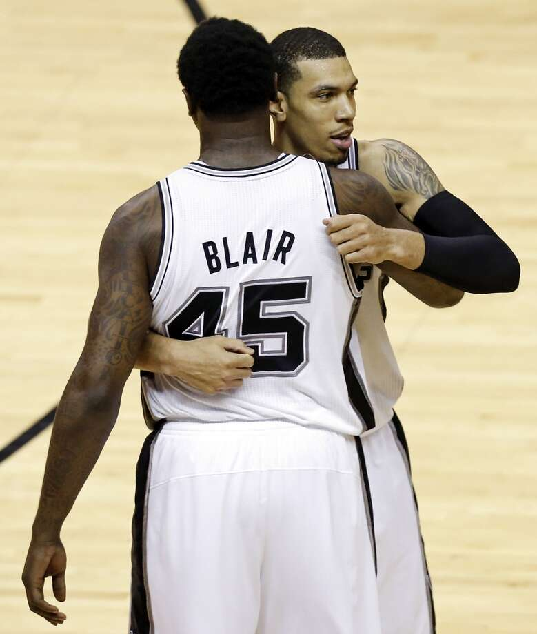 San Antonio Spurs' DeJuan Blair hugs San Antonio Spurs' Danny Green as he walks off the court during the second half of Game 3 of the 2013 NBA Finals against the Miami Heat Tuesday June 11, 2013 at the AT&T Center. The Spurs won 113-77.