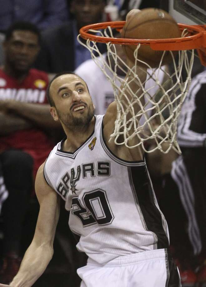 Manu Ginobili (20) dunks the ball during the second half of Game 3 of the NBA Finals at the AT&T Center on Tuesday, June 11, 2013.
