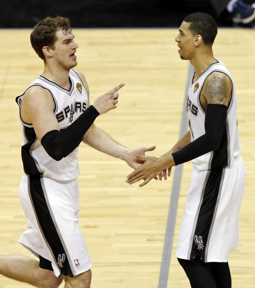 San Antonio Spurs' Tiago Splitter celebrates with teammate San Antonio Spurs' Danny Green after a play during the second half of Game 3 of the 2013 NBA Finals against the Miami Heat Tuesday June 11, 2013 at the AT&T Center. The Spurs won 113-77.