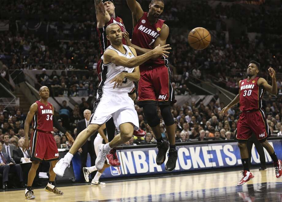 San Antonio Spurs' Tony Parker passes out to the perimeter against the Miami Heat during the first half of Game 3 of the NBA Finals at the AT&T Center on Tue., June 11, 2013.