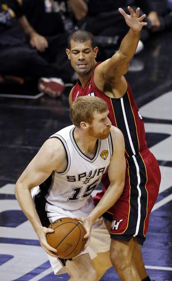 San Antonio Spurs' Matt Bonner looks for room under Miami Heat's Shane Battier during the second half of Game 3 of the 2013 NBA Finals Tuesday June 11, 2013 at the AT&T Center. The Spurs won 113-77.