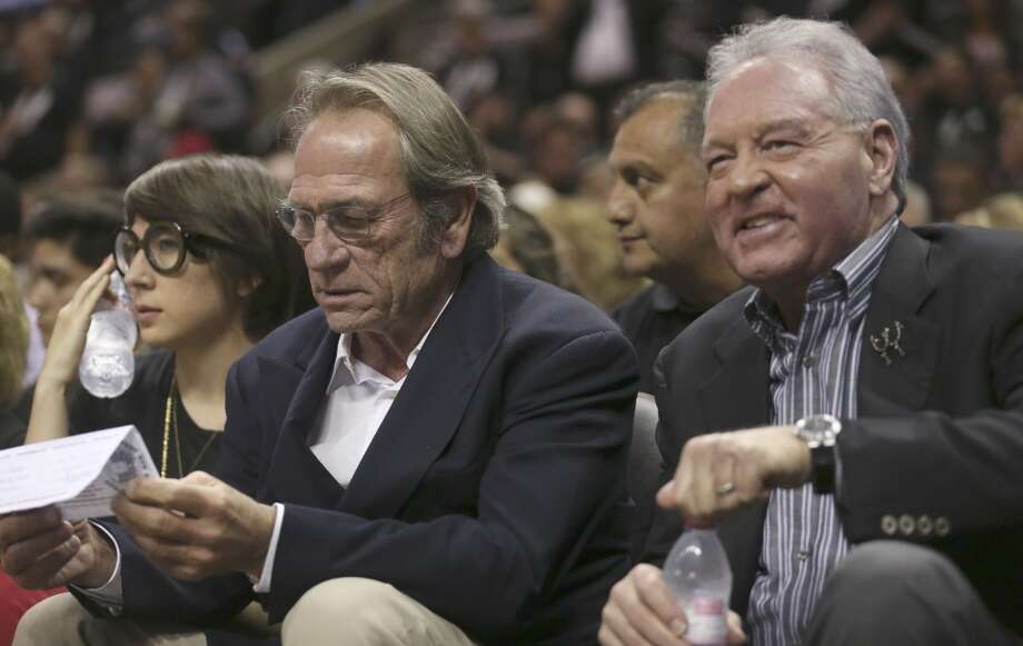 Tommy Lee Jones, left, sits with Spurs owner Peter Holt during the first half of Game 3 of the NBA Finals at the AT&T Center on Tue., June 11, 2013.