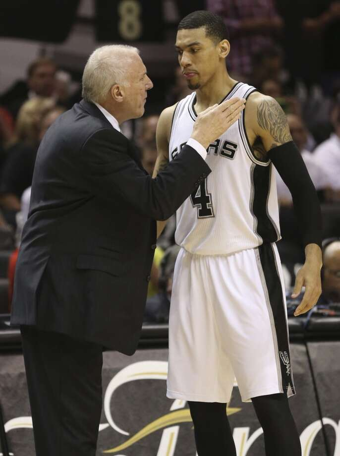 Spurs coach Gregg Popovich, left talks to San Antonio Spurs' Danny Green during the first half of Game 3 of the NBA Finals at the AT&T Center on Tue., June 11, 2013.