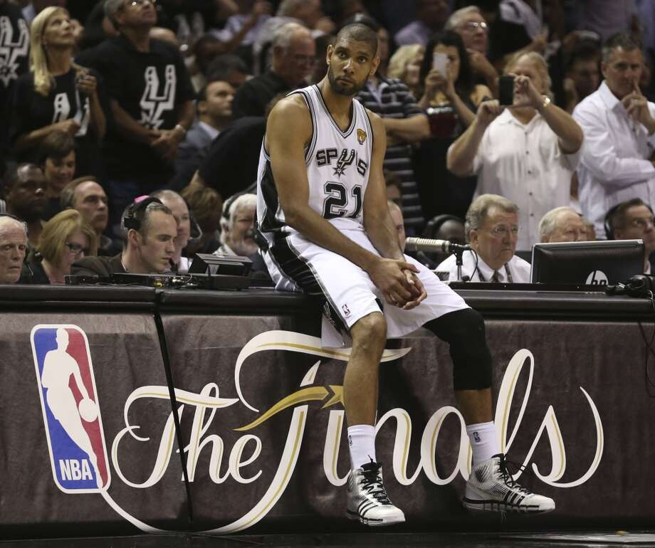 San Antonio Spurs' Tim Duncan waist to come into the game during the first half of Game 3 of the NBA Finals at the AT&T Center on Tue., June 11, 2013.