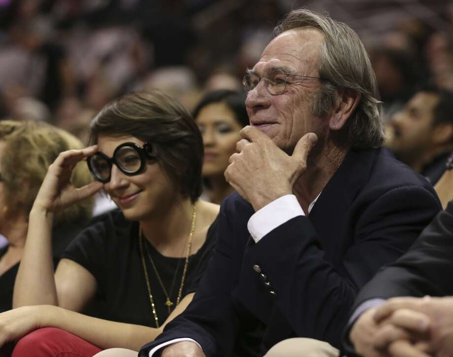 Actor Tommy Lee Jones sits on the sidelines during the first half of Game 3 of the NBA Finals at the AT&T Center on Tue., June 11, 2013.