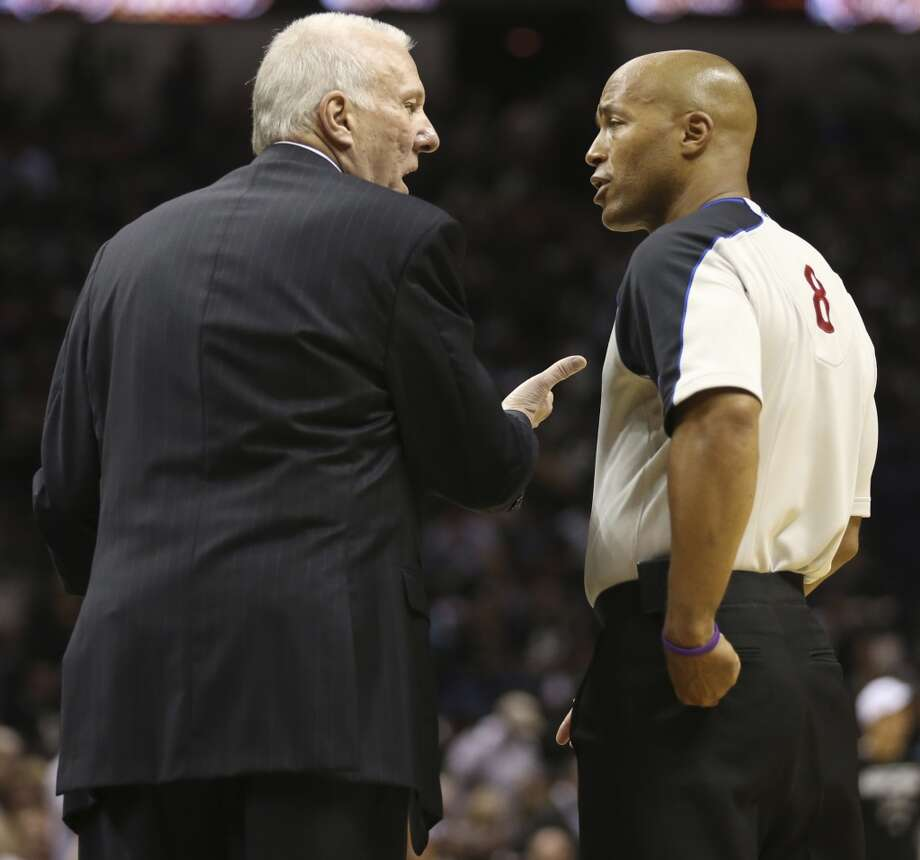 Spurs coach Gregg Popovich, left talks with referee Marc Davis during the first half of Game 3 of the NBA Finals at the AT&T Center on Tue., June 11, 2013.