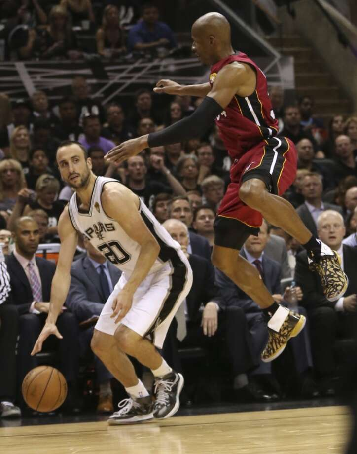 San Antonio Spurs' Manu Ginobili tries to get clear of Miami Heat's Ray Allen during the first half of Game 3 of the NBA Finals at the AT&T Center on Tue., June 11, 2013.