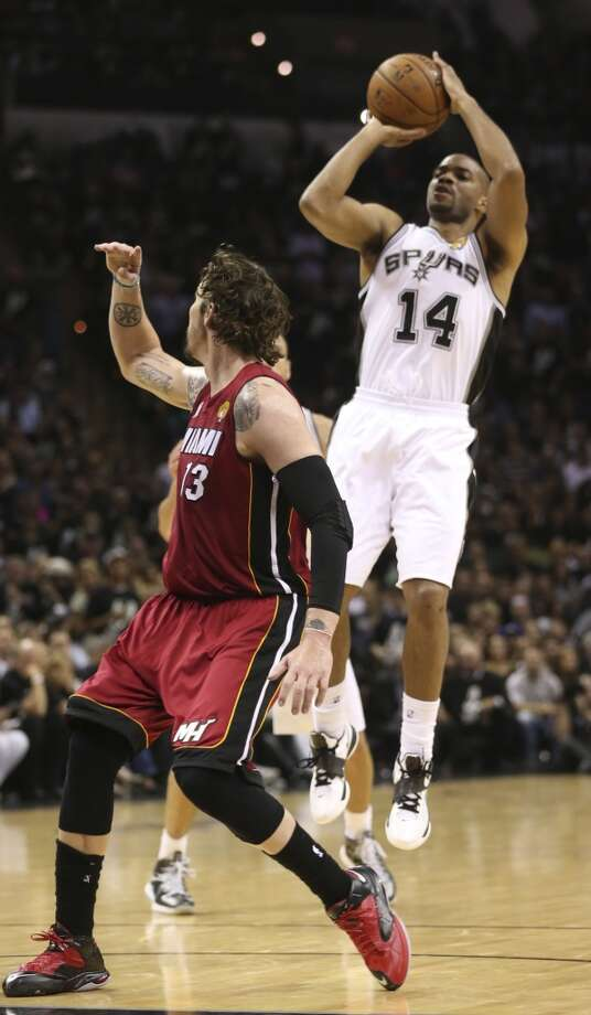 San Antonio Spurs' Gary Neal shoots a three-pointer over Miami Heat's Mike Miller during the second half of Game 3 of the NBA Finals at the AT&T Center on Tue., June 11, 2013. The scored sixteen 3-pointers to win 113-77 and lead the series, 2-1.