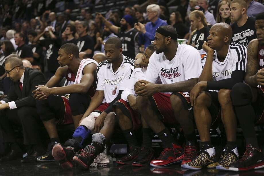 The Miami Heat star players sit out late in the fourth quarter as they go on to lose to the San Antonio Spurs in Game 3 of the NBA Finals at the AT&T Center on Tue., June 11, 2013. The Spurs won 113-77.