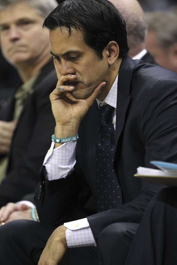 Miami Heat head coach Erik Spoelstra sits on the bench late in the fourth quarter as they go on to lose to the San Antonio Spurs in Game 3 of the NBA Finals at the AT&T Center on Tue., June 11, 2013. The Spurs won 113-77. The Spurs lead the series 2-1.