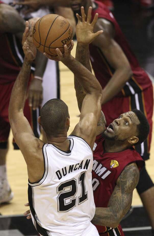 Tim Duncan (21) shoots over Udonis Haslem (40) during the second half of Game 3 of the NBA Finals at the AT&T Center on Tuesday, June 11, 2013.