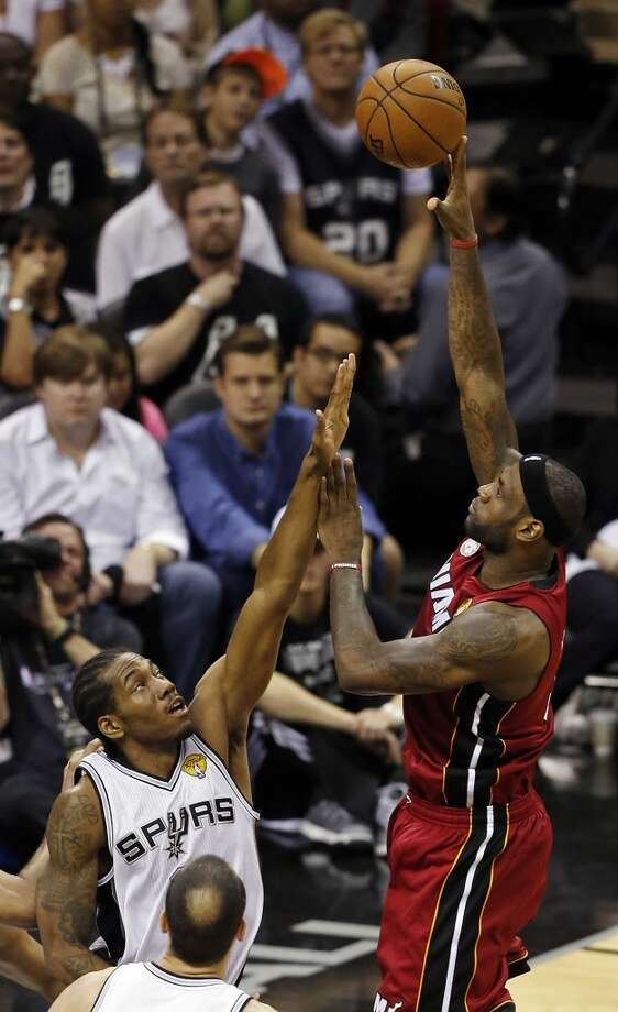 Miami Heat's LeBron James shoots over San Antonio Spurs' Kawhi Leonard during the first half of Game 3 of the 2013 NBA Finals Tuesday June 11, 2013 at the AT&T Center.