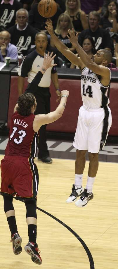 Spurs' Gary Neal (14) shoots over Heat's Mike Miller during the first half of Game 3 of the NBA Finals at the AT&T Center on Tuesday, June 11, 2013.