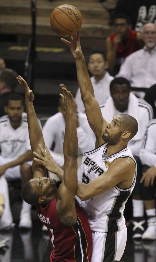 Spurs' Tim Duncan (21) shoots over Heat's Chris Bosh during the first half of Game 3 of the NBA Finals at the AT&T Center on Tuesday, June 11, 2013.