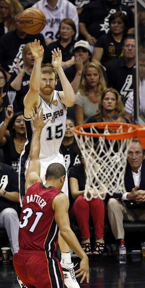 San Antonio Spurs' Matt Bonner shoots over Miami Heat's Shane Battier during the first half of Game 3 of the 2013 NBA Finals Tuesday June 11, 2013 at the AT&T Center.