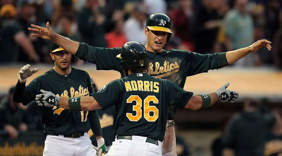 Oakland Athletics' Adam Rosales (17) and Nate Freiman (7) greet Derek Norris after his three run homeer against the New York Yankees in the 4th inning of their MLB  baseball game Tuesday, June 11, 2013, in Oakland, Calif. Photo: Lance Iversen, The Chronicle