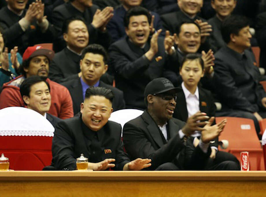 Former NBA player Dennis Rodman (right, in foreground) sits next to North Korea's Kim Jong-un to watch basketball.