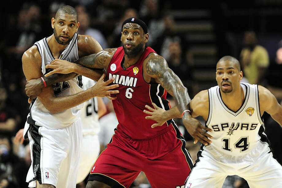 Tim Duncan (L) and Gary Neal (R) of the San Antonio Spurs play tight defense on LeBron James of the Miami Heat during game 3 of the NBA finals against the Miami Heat on June 11, 2013 in San Antonio, Texas. The Spurs defeated the Heat 113-77 to take a 2-1 lead in the best-of-seven championship series.    AFP PHOTO/Frederic J. BROWNFREDERIC J. BROWN/AFP/Getty Images Photo: Frederic J. Brown, AFP/Getty Images