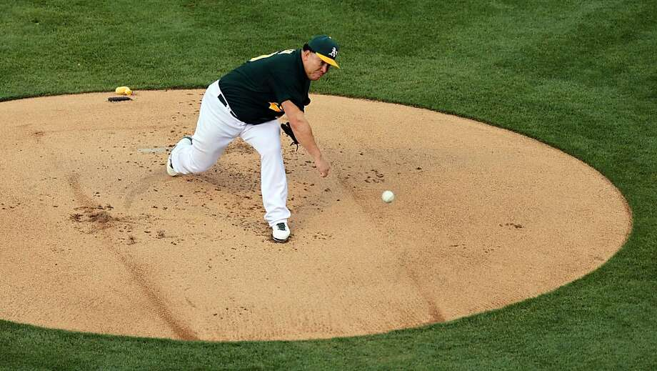Oakland Athletics' Bartolo Colon throws to the New York Yankees in the first inning of a baseball game Tuesday, June 11, 2013, in Oakland, Calif. Photo: Lance Iversen, The Chronicle