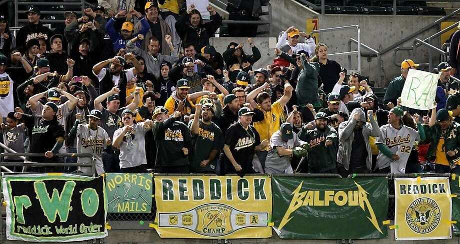 Oakland Athletics' fans in right field celebrate as pitcher Grant Belfour is introduced in the 9th inning during their MLB baseball game with the New York Yankees Tuesday, June 11, 2013, in Oakland, Calif. A's won 6-4 Photo: Lance Iversen, The Chronicle