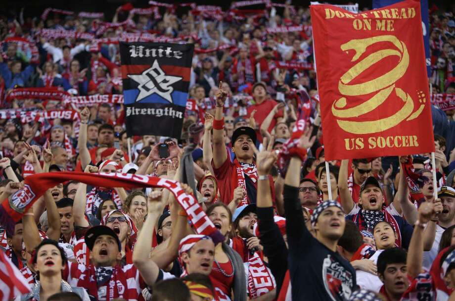U.S. fans erupt in cheers during a World Cup qualifying match against Panama on Tuesday, June 11, 2013 at CenturyLink Field in Seattle. The U.S. defeated Panama 2-0. Photo: JOSHUA TRUJILLO, SEATTLEPI.COM / SEATTLEPI.COM