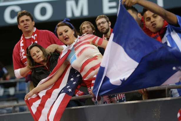 U.S. fans cheer on their team during a World Cup qualifying match against Panama on Tuesday, June 11, 2013 at CenturyLink Field in Seattle. The U.S. defeated Panama 2-0.