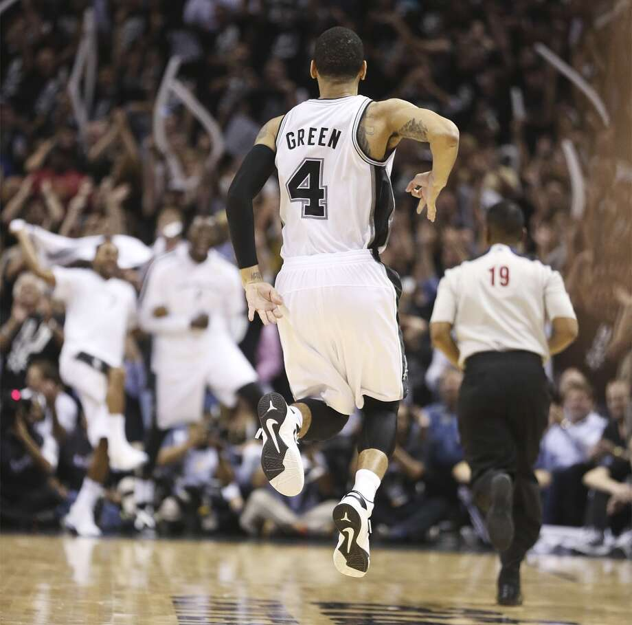 San Antonio Spurs Danny Green celebrates one of his 7 three-pointers against the Miami Heat in Game 3 of the NBA Finals at the AT&T Center on Tue., June 11, 2013. The Spurs won 113-77 and lead the series 2-1.