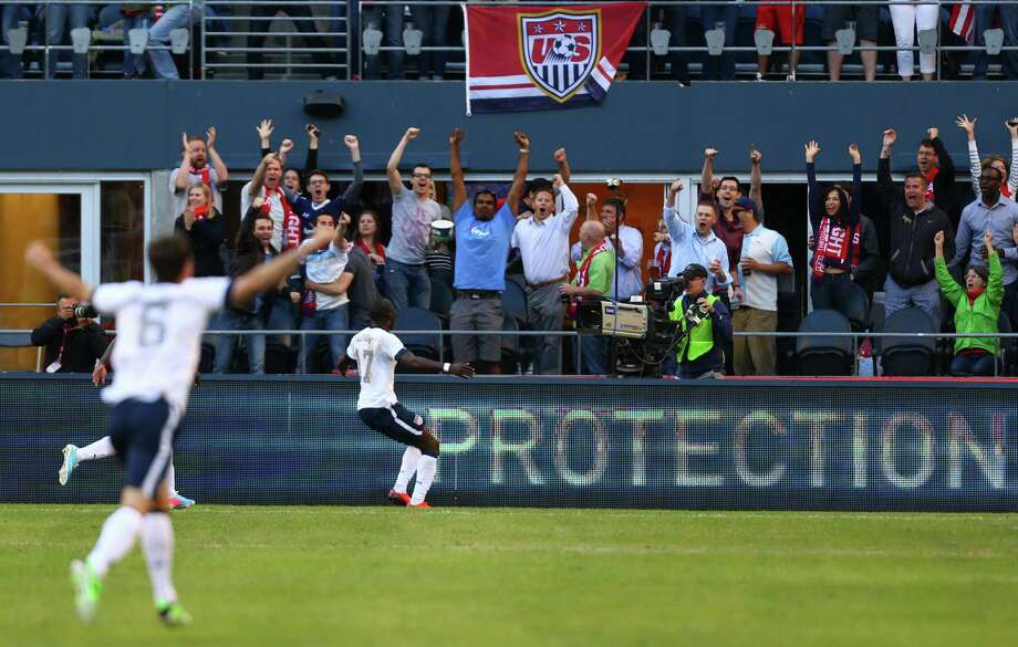 U.S. fans and players react to a first-half goal by Jozy Altidore during a World Cup qualifying match against Panama on Tuesday, June 11, 2013 at CenturyLink Field in Seattle. The U.S. defeated Panama 2-0. Photo: JOSHUA TRUJILLO, SEATTLEPI.COM / SEATTLEPI.COM