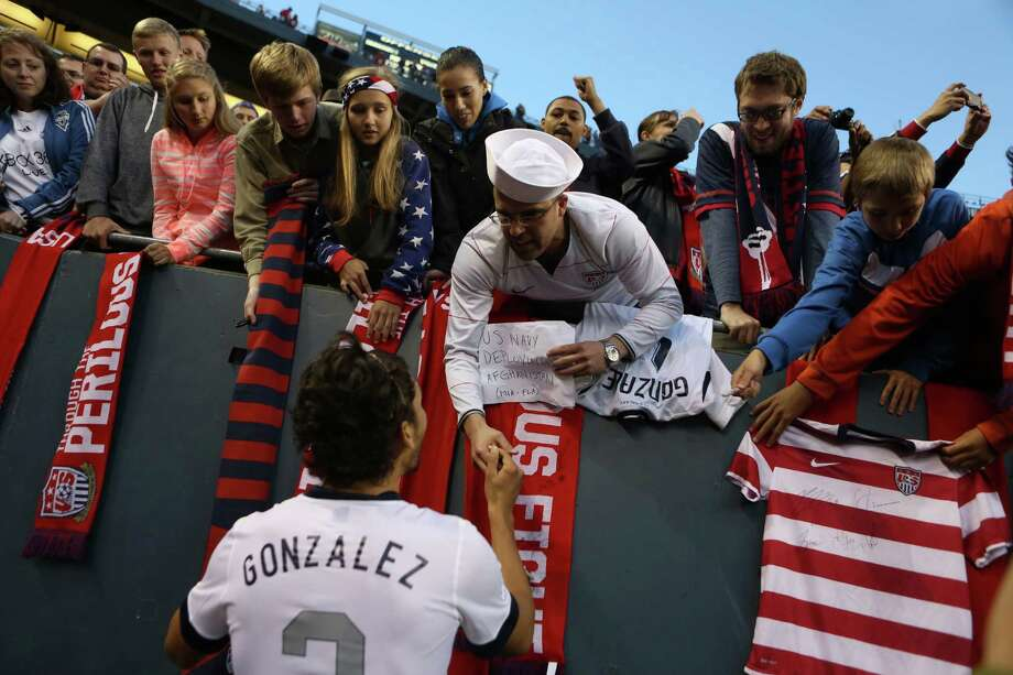 U.S. player Omar Gonzales signs autographs after a World Cup qualifying match against Panama on Tuesday, June 11, 2013 at CenturyLink Field in Seattle. The U.S. defeated Panama 2-0. Photo: JOSHUA TRUJILLO, SEATTLEPI.COM / SEATTLEPI.COM