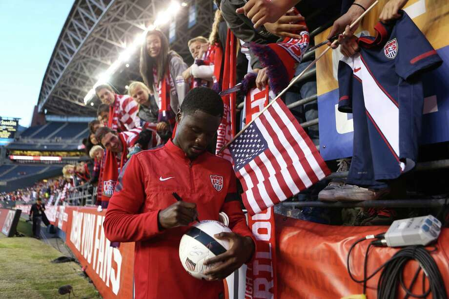 Eddie Johnson signs autographs after a World Cup qualifying match against Panama on Tuesday, June 11, 2013 at CenturyLink Field in Seattle. The U.S. defeated Panama 2-0. Photo: JOSHUA TRUJILLO, SEATTLEPI.COM / SEATTLEPI.COM