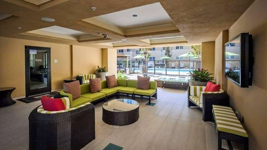 The common areas are  considered by the owners to be one of the most unique selling points of these rentals. This is a breezeway passage.
