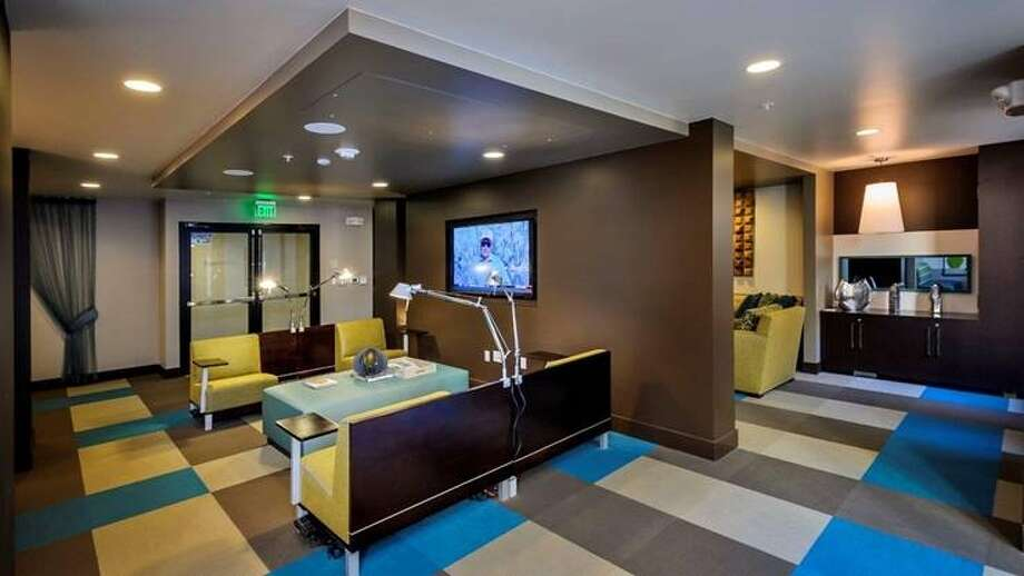 A media center where you can plug in your laptop for a movie night.
