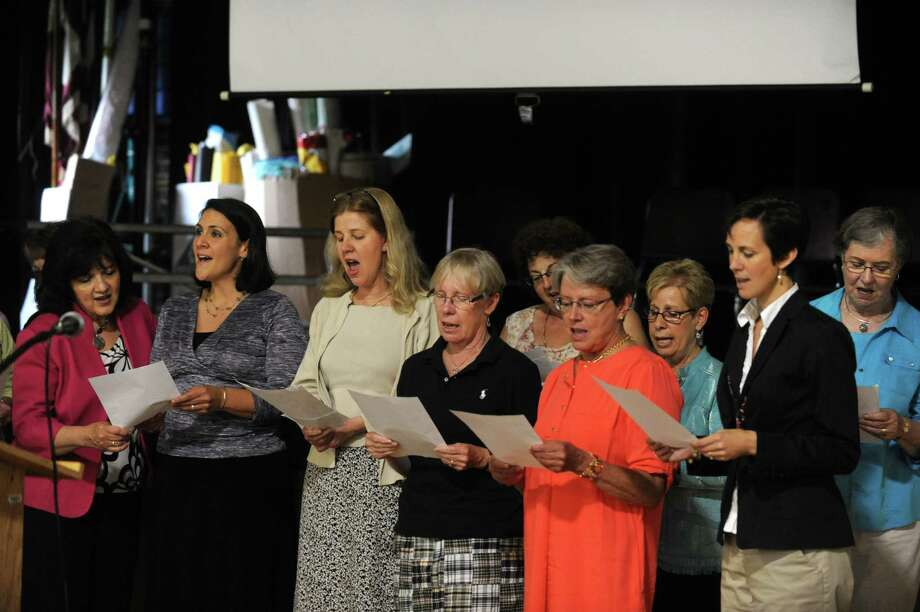 Elsmere Elementary School teachers, who worked under former school principal Dorothy Whitney,  sing during a memorial and plaque dedication to the principal of Elsmere school for close to 20 years at the school on Tuesday June 11, 2013 in Delmar, N.Y.  (Michael P. Farrell/Times Union) Photo: Michael P. Farrell