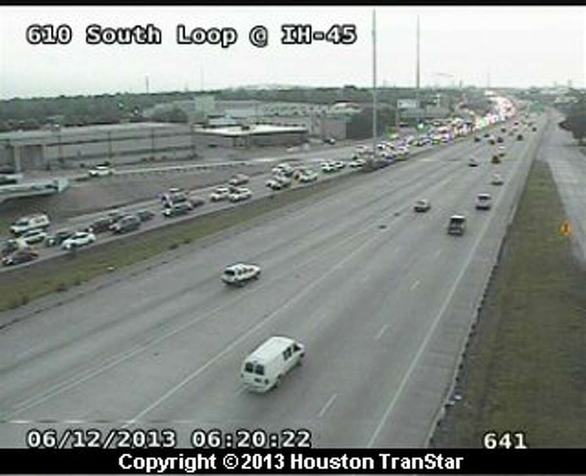 Traffic was jammed on the westbound South Loop after a roll-over wreck near Woodridge Wednesday morning.