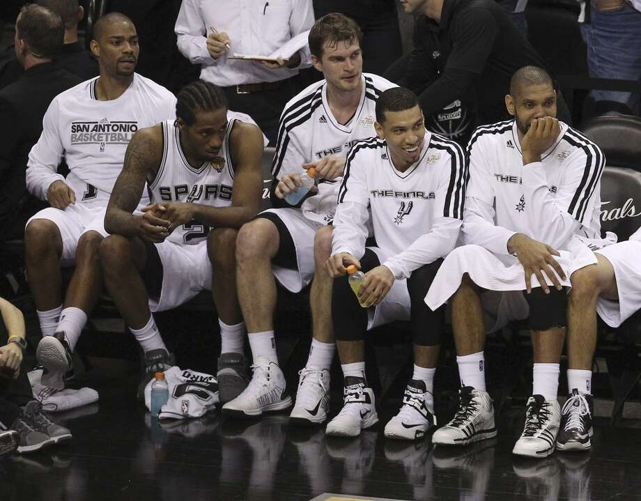 The Spurs bench looks pleased with their play against the Miami Heat during Game 3 of the NBA Finals at the AT&T Center on Tuesday, June 11, 2013. (Kin Man Hui/San Antonio Express-News)