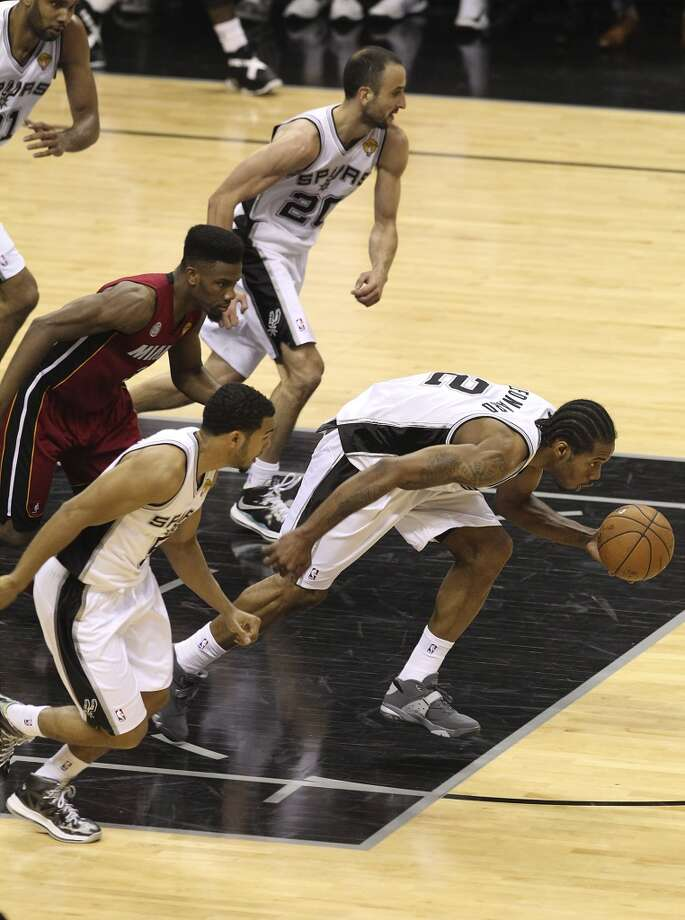Spurs' Kawhi Leonard (02) leads the break after getting a steal against Miami during the second half of Game 3 of the NBA Finals at the AT&T Center on Tuesday, June 11, 2013. (Kin Man Hui/San Antonio Express-News)